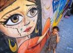 Bağdat'ın Köhne Sokakları Gönüllü Gençlerin Renkli Çizimleriyle Canlanıyor